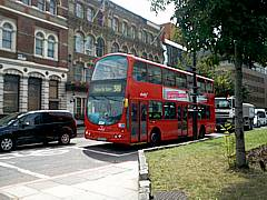The famous double-decker red bus takes people on tours of downton London