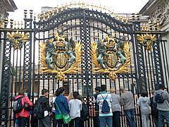 Looking through the gates at Buckingham Palace, hoping to see the Queen